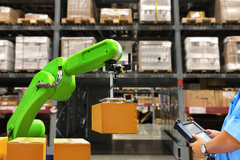 Robot carries box in warehouse
